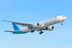 Airplane Garuda Indonesia PK-GIC Boeing 777-300 is landing at Schiphol airport. Royalty Free Stock Photos