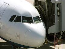 Airplane at gate. A commercial airplane at gate Stock Photo