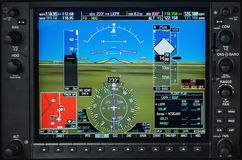 Airplane glass cockpit display with weather radar and engine gauges Stock Photos