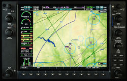 Airplane glass cockpit display with weather radar and engine gauges Royalty Free Stock Photo