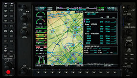 Airplane glass cockpit display with weather radar and engine gauges. Airplane glass cockpit display with terrain and engine gauges in small private airplane Stock Photos
