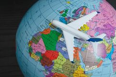 Airplane on the globe. Travel concept. Close up.  stock photography