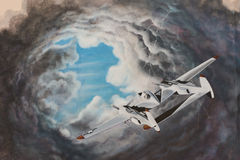 Airplane Going into a Storm. Painted mural of an airplane flying into a storm Royalty Free Stock Photography