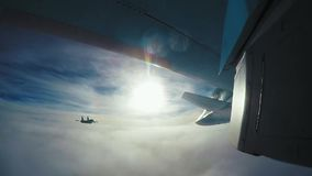 Airplane, Gopro, SU-34. Plane above the clouds. Gopro shot under the wing, SU-34 stock footage