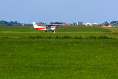 Airplane on grass strip. Small propeller airplane taxiing on grass airport Royalty Free Stock Photography