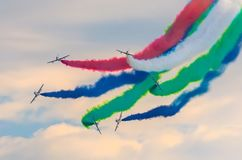 Airplane group fighter against the background of color smoke. Royalty Free Stock Photos