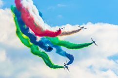 Airplane group fighter against the background of color smoke. Stock Photography