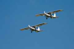 Airplane. A group of small propeller airplanes in red, blue and white on a flight show flying in the air Stock Images