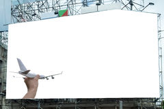 Airplane on hand with white large billboard advertise. Airplane on hand with blank white large billboard advertise Royalty Free Stock Image