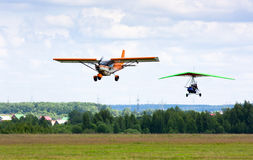 Airplane and hang-glider Stock Images