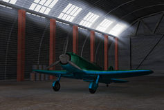 Airplane in hangar. Antique green fighter airplane in metall hangar Royalty Free Stock Photos