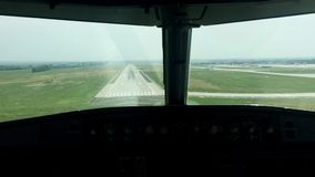 Airplane has a hard landing in summer day.Camera in cabin of pilot stock footage