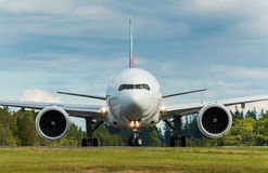 Airplane head shot turning on the runway Royalty Free Stock Image