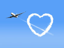 Airplane with Heart Shaped Cloud. Royalty Free Stock Image