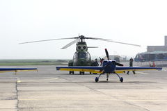 Airplane and helicopter Royalty Free Stock Photos