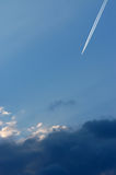 Airplane at high altitude. Airplane flying above thunderstorm clouds at high altitude Royalty Free Stock Image