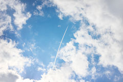Airplane high in blue sky Stock Image