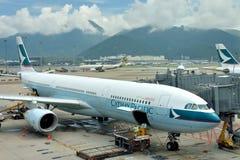 Airplane in Hongkong Airport Stock Photo