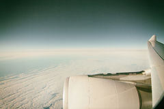 Airplane and horizon. Sideview of the sky and the wing of a commercial airplane Royalty Free Stock Image