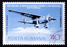 Airplane ICAR Comercial, circa 1976. MOSCOW, RUSSIA - FEBRUARY 12, 2017: A stamp printed by Romania, shows airplane ICAR Comercial, circa 1976 Stock Photography