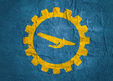 Airplane icon in gear Stock Images