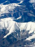 Airplane image with the Carpathian mountains from Romania royalty free stock photography