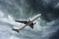 Airplane on impressive gray cloud before rain Royalty Free Stock Photography