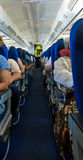 Airplane inside with tourists Royalty Free Stock Image