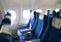 Airplane interior. Seat rows in an airplane cabin Stock Photo