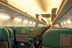 Airplane Interior. Corridor and Seats in Airplane Royalty Free Stock Photography