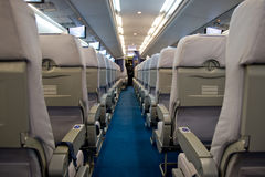Airplane interior with chear rows. Seat rows inside new aircraft. Color screens. Ukraine Stock Photo