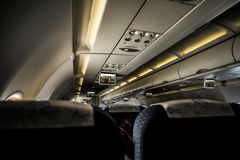 Airplane interior with entertainment center Stock Photography