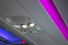 Airplane interior lighting. Multicolored interior lighting inside of a modern plane royalty free stock photography