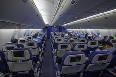 Airplane interior with passengers Stock Photo