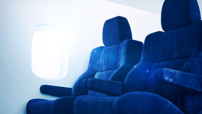 Airplane interior with sunlight Stock Image