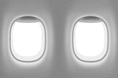 Airplane interior with two windows Stock Image