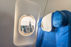 Airplane interior with view on New York City. Tourism and travel Stock Photography