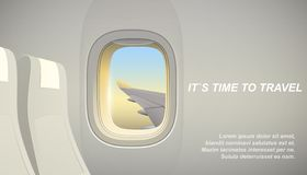 Airplane interior with view to the wing. Vacation time concept royalty free illustration