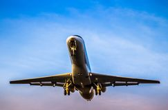 Airplane ist landing. Front view of a jet airplane approaching an airport for landing Stock Images