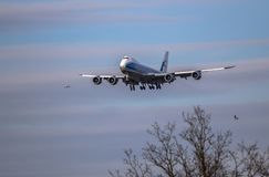 Airplane ist landing. Front view of a jet airplane approaching an airport for landing Royalty Free Stock Photography