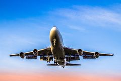 Airplane ist landing. Front view of a jet airplane approaching an airport for landing Stock Photography