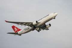 Airplane. ISTANBUL, TURKEY - NOVEMBER 21, 2015: Turkish Airlines Airbus A330-223 (CN 949) takes off from Istanbul Ataturk Airport. THY is the flag carrier of Royalty Free Stock Images
