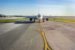 Airplane on its runway at the airport. The other plane taking off Stock Image