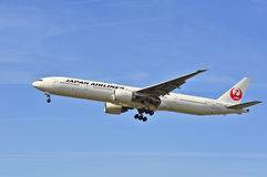 Airplane of Japan Airlines above Frankfurt airport Stock Photography