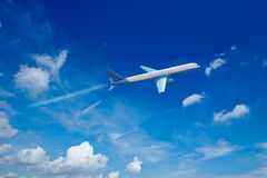 Airplane jet in blue sky Royalty Free Stock Photo
