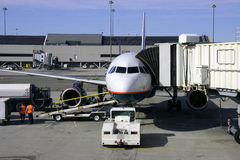 Airplane and Jetway. A commercial airplane and jetway royalty free stock photos