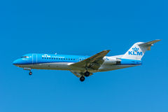 Airplane KLM Cityhopper PH-KZO Fokker F70. Schiphol, Noord-Holland/Netherlands - June 16-06-2016 - Airplane KLM Cityhopper PH-KZO Fokker F70  is flying to the Royalty Free Stock Photography