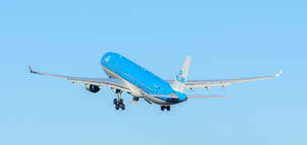 Airplane KLM Royal Dutch Airlines PH-AKF Airbus A330-300 is taking off at Schiphol airport. Stock Photos