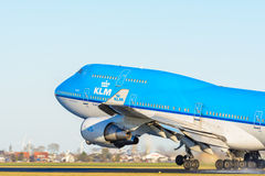 Airplane from KLM Royal Dutch Airlines PH-BFN Boeing 747-400 is taking off at Schiphol airport. Royalty Free Stock Photos