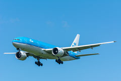 Airplane KLM Royal Dutch Airlines PH-BQB Boeing 777-200 is flying to the runway. Stock Images